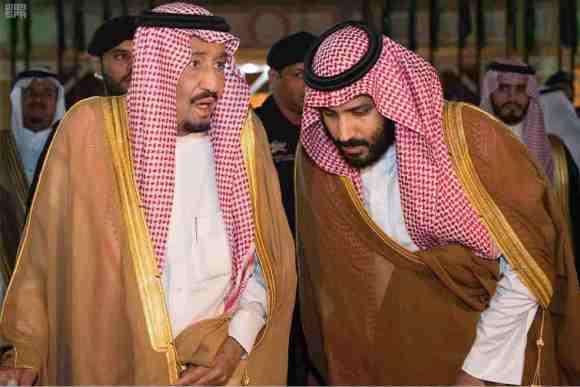 Saudi Arabia's King Salman bin Abdulaziz Al Saud chats with his son and Crown Prince Mohammed bin Salman Wednesday. (Saudi Press Agency/Handout via Reuters)