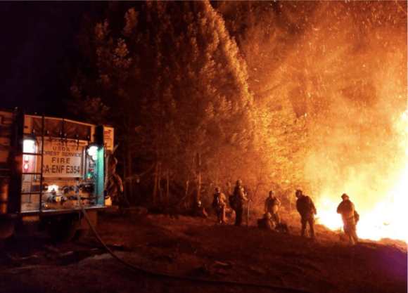 A photo made available by handout from the United States Forest Service and the National Wildfire Coordinating Group showing firefighter battling the Camp Fire.