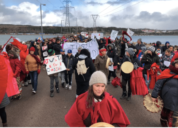 A rally in memory of Cassidy Bernard shut down the Canso Causeway with many people wearing red to show solidarity for missing and murdered women and girls. Courtesy CBC/Robin Short