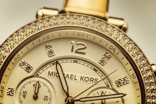 gold and diamond Michael Kors watch