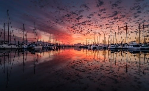 marina with sail boats sunset