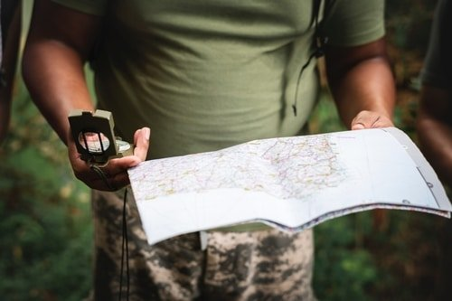 soldier reading map and compass