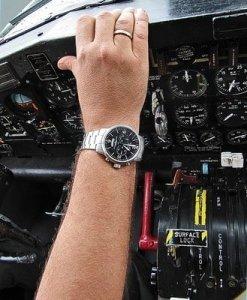 pilots wristwatch in cockpit