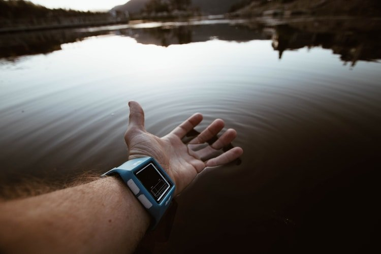 wristwatch being submerged in water