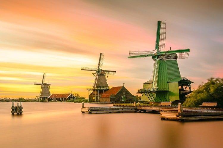 three windmills in holland