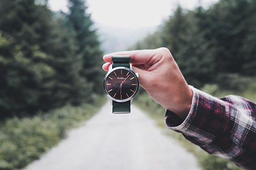 Person holding a minimalist watch for men