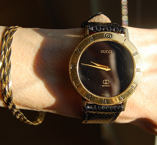 Wearing Gucci watch