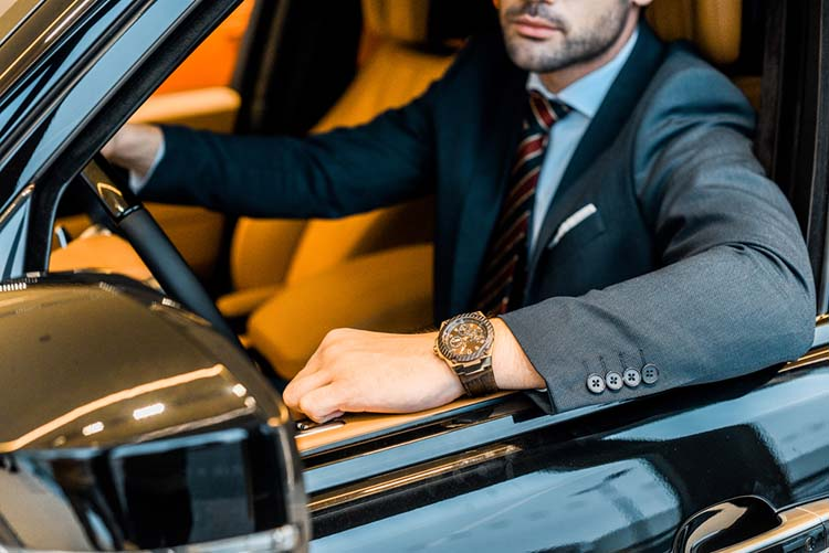 businessman with luxury watch in vehicle