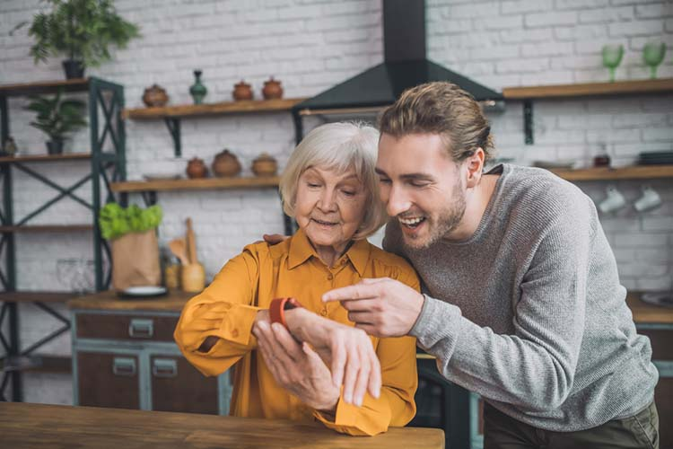 Elderly with son using the smartwatch