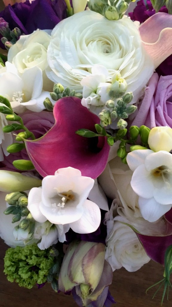 The bridal bouquet. Thank you, Holiday Flowers!