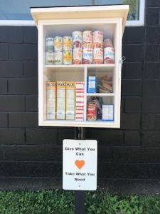 Cabinet containing food mounted on post
