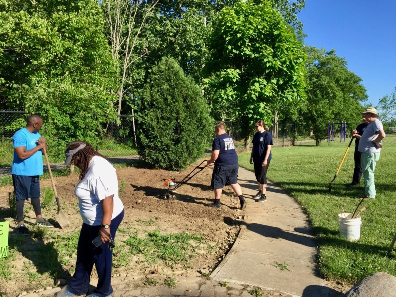 Woodlawn Fire and EMS volunteers tilling soil for community garden