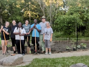 WeTHRIVE! team and volunteers in front of prepared garden site at Woodlawn Miss Mary's garden