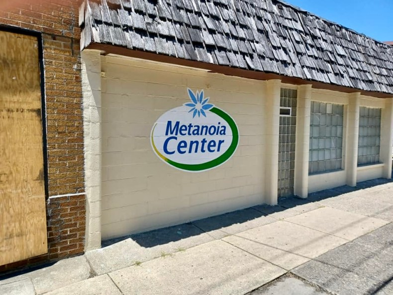 front of building with metanoia center logo