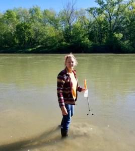 woman walking in river