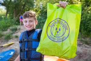 boy holding up litter bag