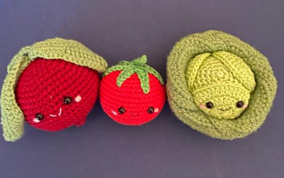 three crocheted vegetable characters