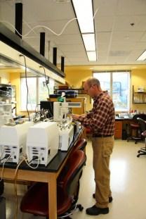 Dave Mitchum runs the auto analyzer