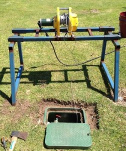 Portable winch used to pull up submersible pumps