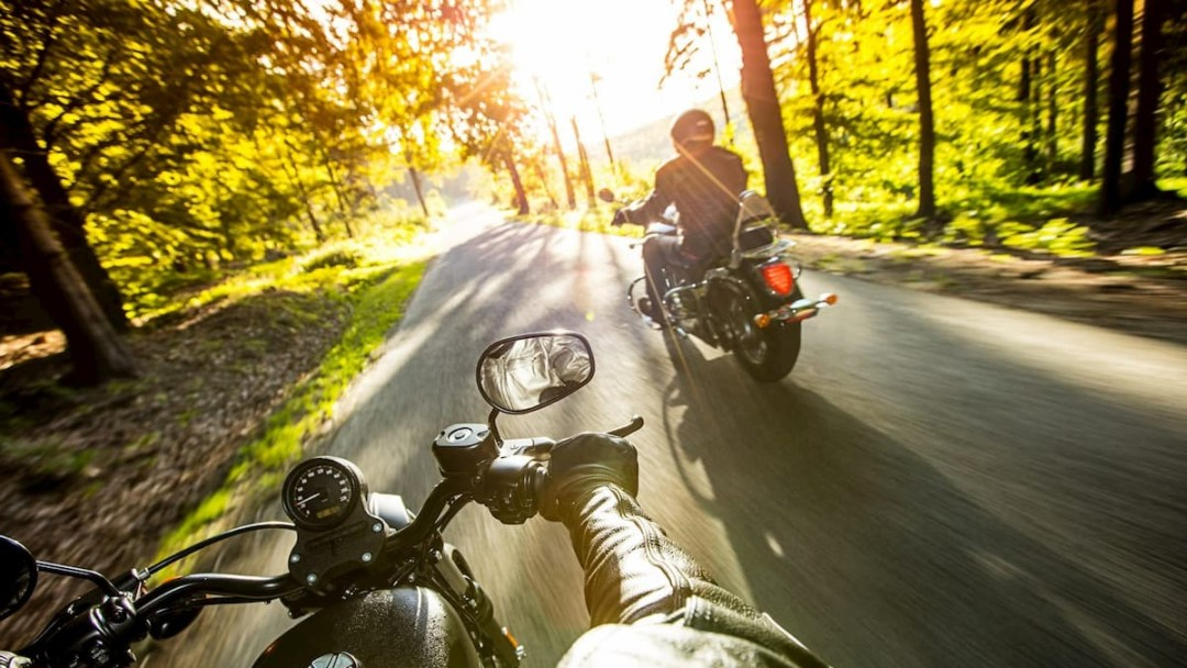 Two people motorcycling on some smooth roads close to Westport, Ontario.