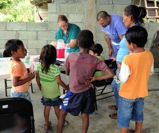 busy nurse attending to children