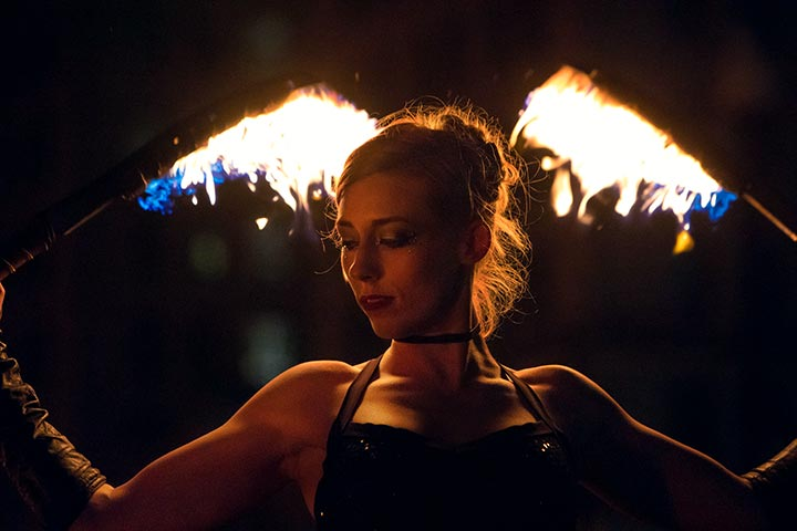 Fire spinner Ember Flynne performs at WaterFire. Photograph by Kevin Murray.
