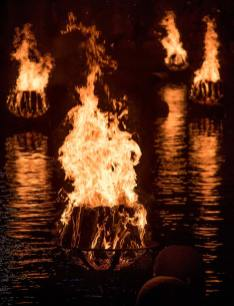 Braziers burning brightly, photograph by Jen Bonin.