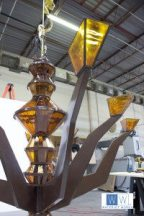 Chandelier hanging in the workshop fully assembled