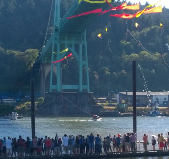 Greenpeace volunteers being lowered from the Bridge to clear passage for the Fennica.