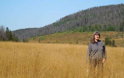 Mary Ann Aschenbrenner in a Rocky Mountain field.