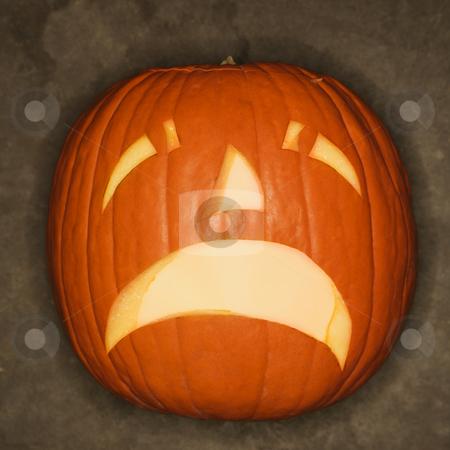 sad carved pumpkin. stock