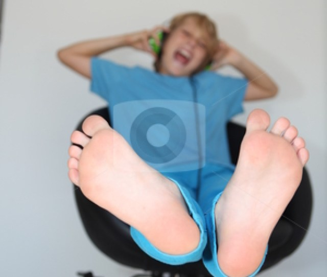 Elegant Happy Kid Listening To Music Focus On Feet With Boys Feet