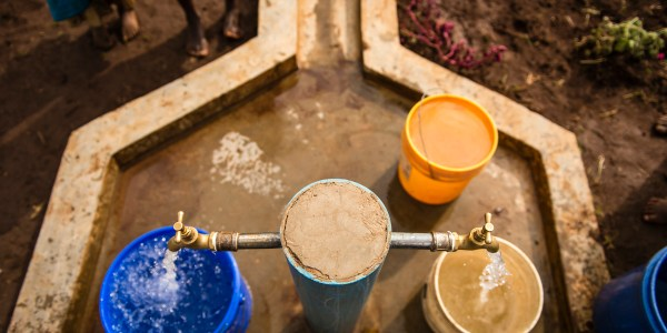 Safe water flows from a tap in Mlondwe, Tanzania.