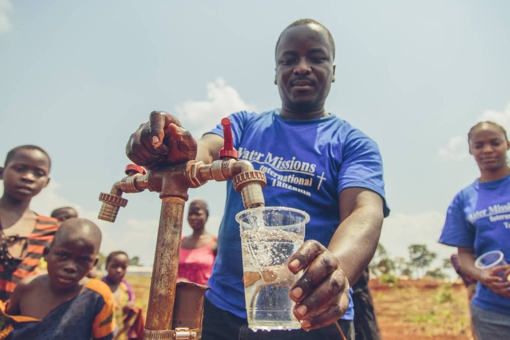 Water Mission staff with clean water.