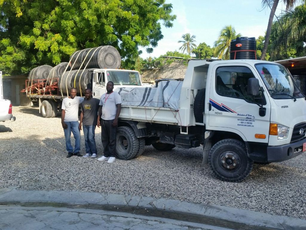 Water Mission Haiti staff load up water treatment systems onto trucks.