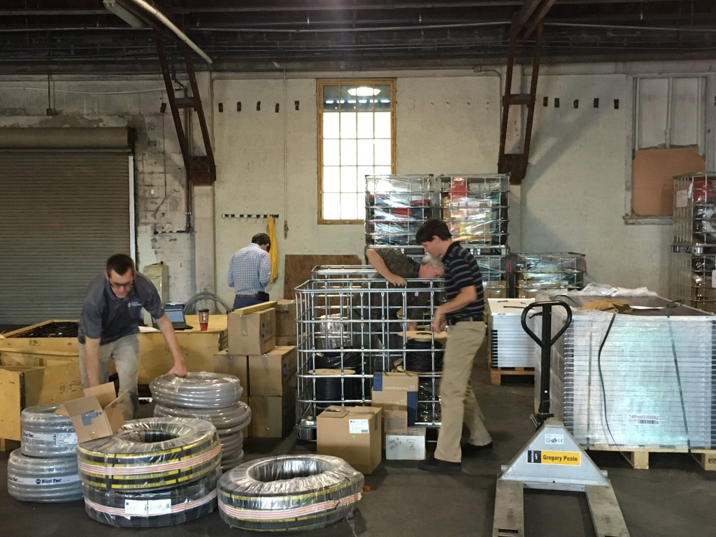Water Mission staff organize treatment systems bound for Haiti.