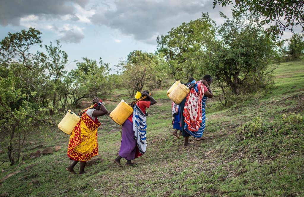 Women in Kenya walk for dirty water.