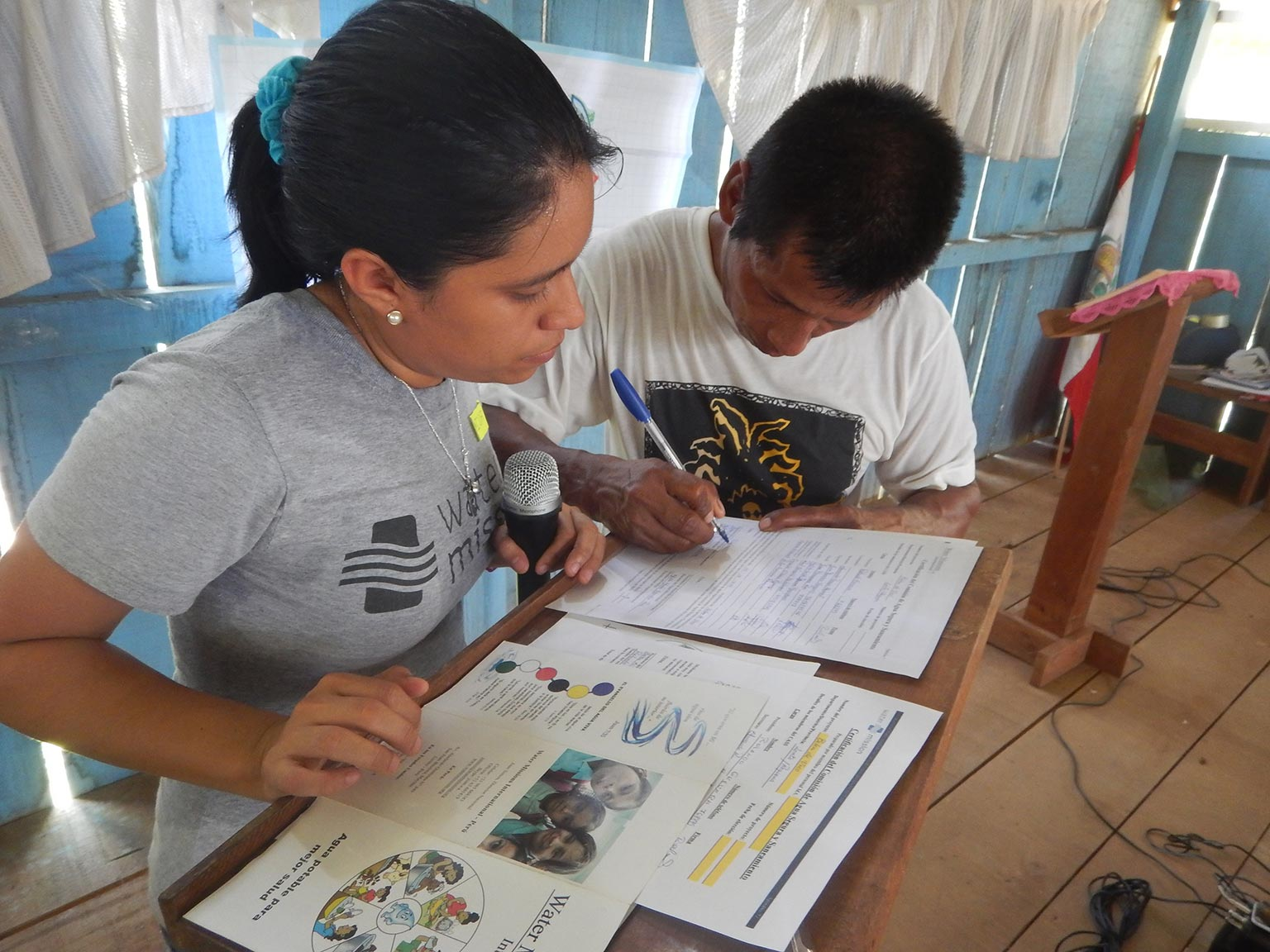 Water Mission Peru staff train community safe water committee members on proper hygiene practices.
