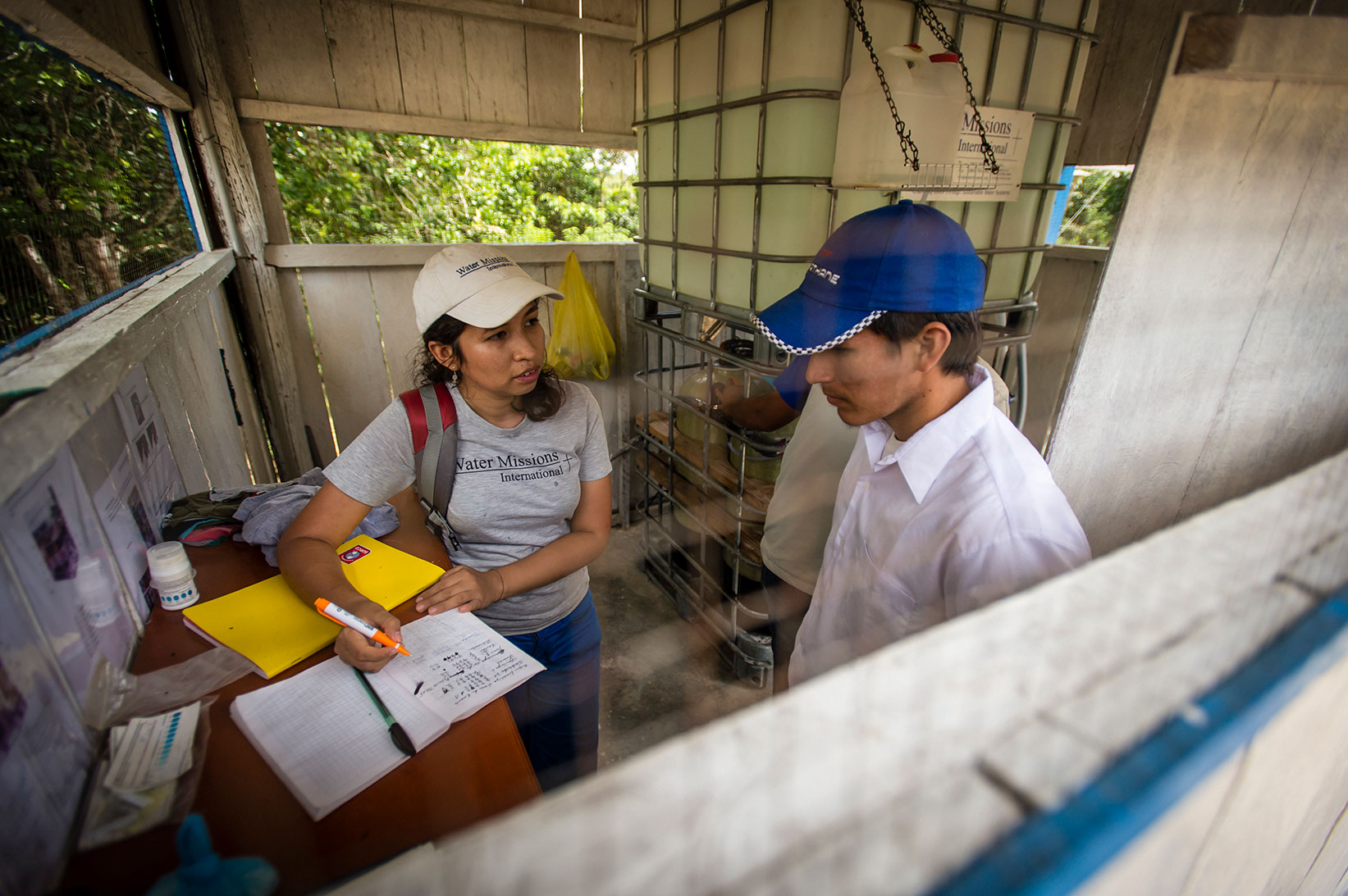 A Water Mission staff member teaches about sustainability.