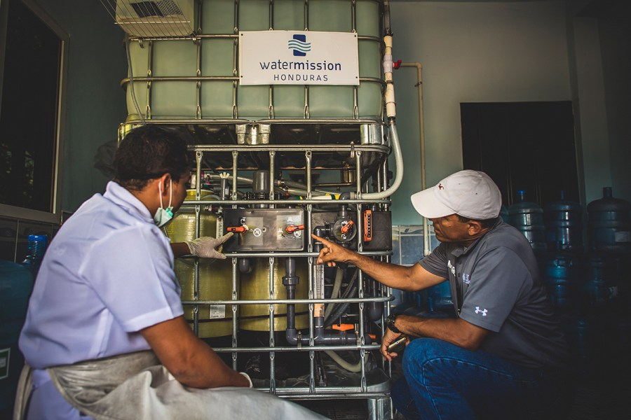 Engineers work on a safe water system in Honduras.