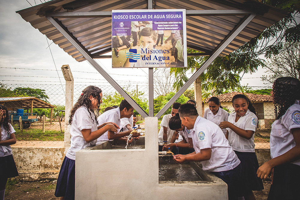 Students in Honduras drink safe water at school.