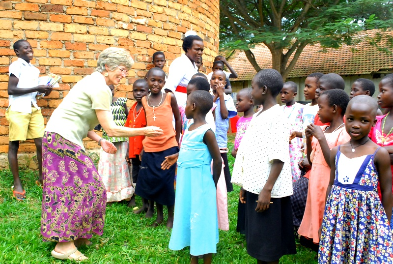 Molly Greene greets children at St. Francis Hospital in Uganda.