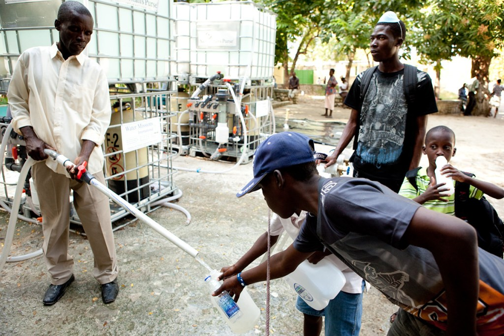 Drawing water from Water Mission treatment systems