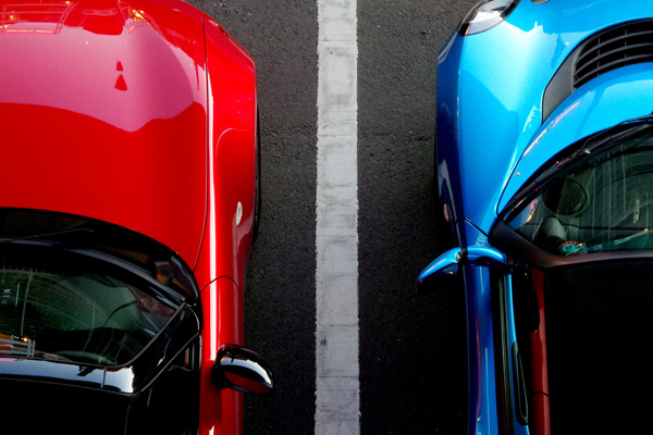Red and Blue Car parked in a parking lot 600