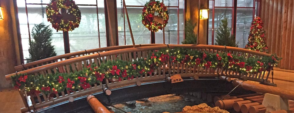 the interior bridge in the lobby of the disney wilderness lodge decorated for christmas 960