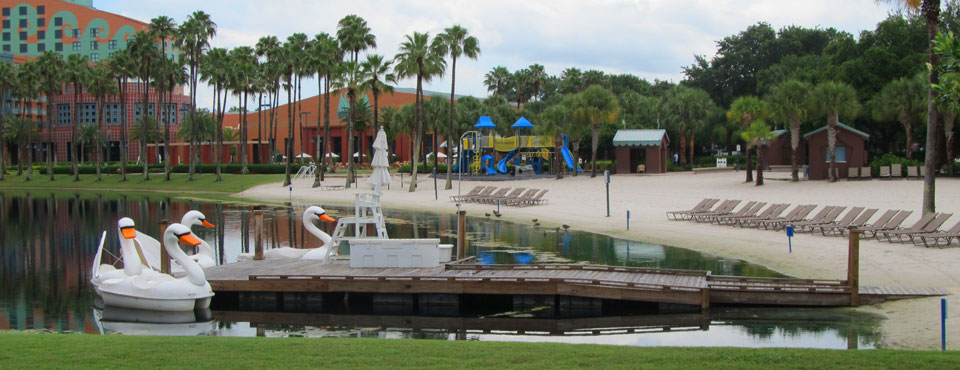 Swam Paddle Boats on the Lake beside the white sandy beach at the Walt Disney World Swan Resort in orlando wide