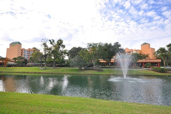 View of the grounds with lake and water features in front of the Radisson Resort Orlando Celebration 600