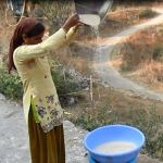 Winnowing done by woman in hills