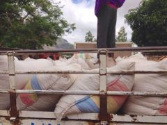 Relief Team loading a truck with 50kg bags of maize ready for distribution in Phalombe and Mulanje Districts.