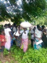 Thank God for His care! The hungry people receiving food! Behind the woman a deacon is checking making sure that there is order!